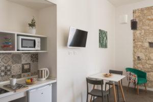studio kitchen with balcony