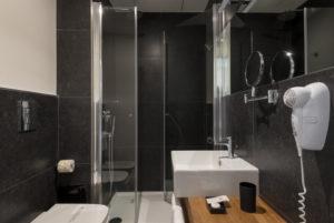 studio bathroom with balcony