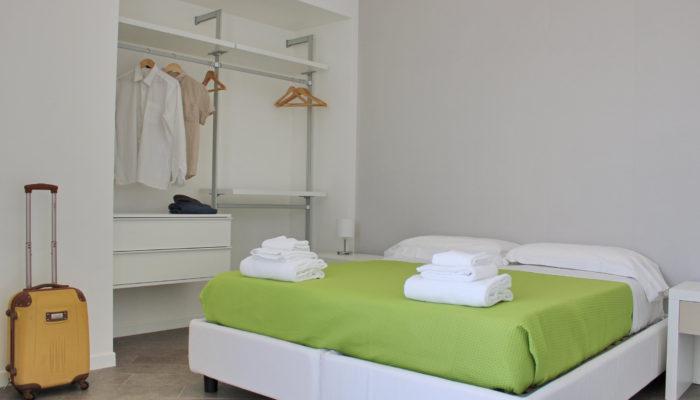 three-room bedroom with balcony
